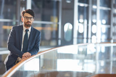Confident Middle Eastern Man in Nighttime Office Building Stock Photos