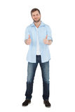 Confident model giving thumbs up to camera Royalty Free Stock Photo