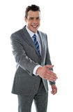 Confident modern businessman offering handshake Royalty Free Stock Images