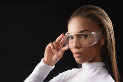 Confident mulatto girl posing with glasses Royalty Free Stock Photo