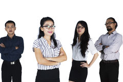 Confident multi ethnic business team. Portrait of multi ethnic business team looking at camera together, isolated on white background Stock Images