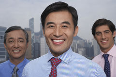 Confident Multiethnic Businessmen Smiling Outdoors Royalty Free Stock Images