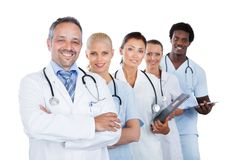 Confident multiethnic medical team standing in row Royalty Free Stock Images