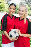 Confident multiethnic soccer players Stock Photo