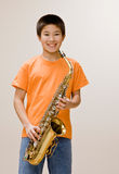 Confident musician holding saxophone stock photo