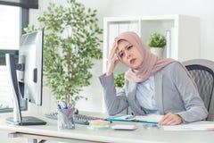 Muslim businesswoman have headache while working