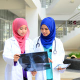 Confident Muslim medical student. Busy conversation at hospital Stock Images
