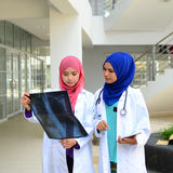 Confident Muslim medical student. Busy conversation at hospital Stock Photography