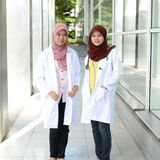 Confident Muslim medical student. Busy conversation at hospital Stock Photo