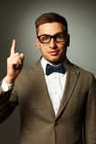 Confident nerd in eyeglasses and bow tie Royalty Free Stock Image