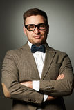 Confident nerd in eyeglasses and bow tie Stock Images