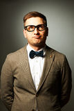 Confident nerd in eyeglasses and bow tie Stock Photography