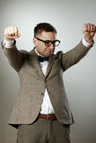 Confident nerd in eyeglasses and bow tie enjoying success Royalty Free Stock Photos