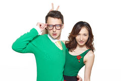 Confident nerd young couple. Interracial weird nerd couple. Caucasian young men and asian women hugging and looking confident at camera wearing 50 style clothes royalty free stock photography