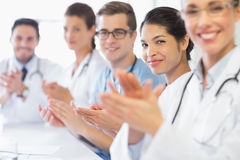 Confident nurse and doctors applauding Royalty Free Stock Photos