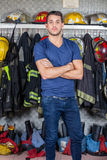 Confident Officer Standing At Fire Station. Portrait of confident officer standing arms crossed at fire station Stock Photos