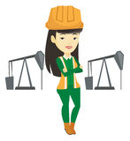 Confident oil worker vector illustration. Asian oil worker in uniform and helmet. Young oil worker standing with crossed arms. Oil worker standing on the Stock Photos