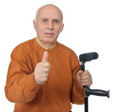 Confident old man holding crutch Royalty Free Stock Photos