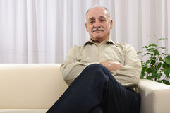 Confident old man at home Stock Photos