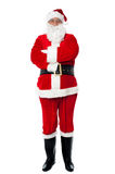 Confident old man in Santa costume Royalty Free Stock Photography