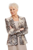 Confident old woman with folded arms stock photography