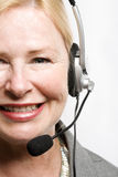 Confident older business woman with headset on Royalty Free Stock Images