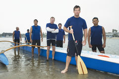 Confident Outrigger Canoeing Team Royalty Free Stock Photo