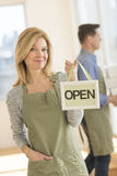 Confident Owner Holding Open Sign In Cafe Stock Image