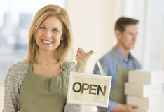 Confident Owner Holding Open Sign In Cafe Royalty Free Stock Images