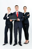 Confident people. Portrait of three confident business partners standing next to each other and looking at camera Stock Photo