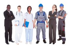 Confident people with diverse occupations. Full length of confident people with diverse occupations standing against white background Royalty Free Stock Photos