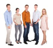Confident people standing over white background. Full length portrait of confident young people standing together over white background Stock Images