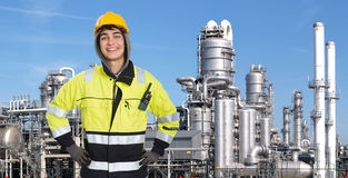 Confident petrochemical engineer. Happy, proud and confident chemical engineer smiling into the camera in front of a petrochemical plabnt, with stainless steel Stock Image