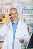 Confident pharmacist calling Royalty Free Stock Image
