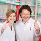 Confident Pharmacists Showing Thumbsup Sign Stock Image
