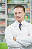 Confident pharmacy chemist man in drugstore Stock Image