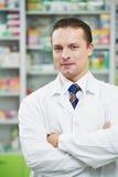 Confident pharmacy chemist man in drugstore Stock Image