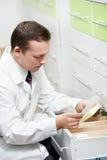 Confident pharmacy chemist man in drugstore Stock Images