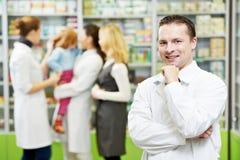 Confident pharmacy chemist man in drugstore Stock Photos
