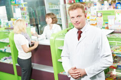 Confident pharmacy chemist man in drugstore Royalty Free Stock Photos
