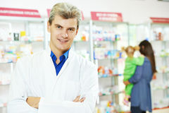 Confident pharmacy chemist man in drugstore Stock Photo