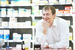 Confident pharmacy chemist man in drugstore Royalty Free Stock Photo