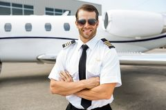 Confident Pilot In Front Of Private Jet Stock Images