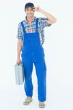 Confident plumber carrying tool box. Full length portrait of confident plumber carrying tool box over white background Stock Image