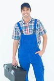 Confident plumber carrying tool box. Portrait of confident plumber carrying tool box over white background Royalty Free Stock Image