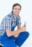 Confident plumber holding adjustable wrench Royalty Free Stock Images