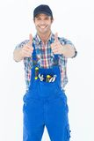 Confident plumber showing thumbs up sign Royalty Free Stock Photo
