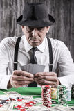 Confident poker player. Royalty Free Stock Images