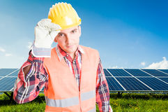 Confident and polite engineer on solar power photovoltaic panel Royalty Free Stock Photos