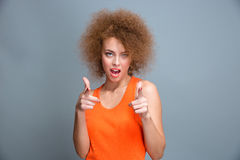 Confident positive happy young woman pointing on you Stock Photos